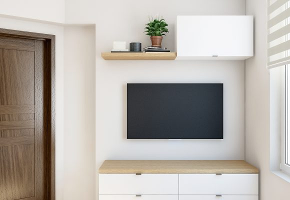 dresser with a TV and a wall cabinet