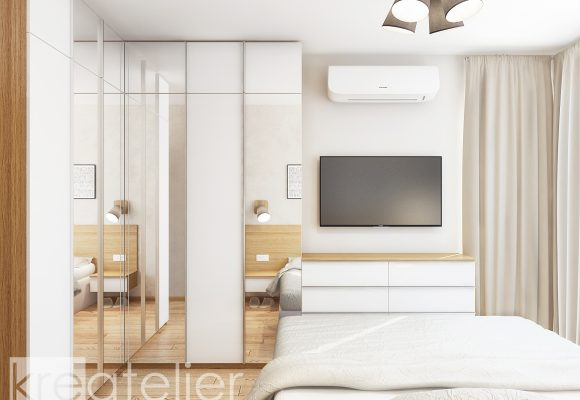 master bedroom with a large wardrobe and a dresser with a wall-mounted TV